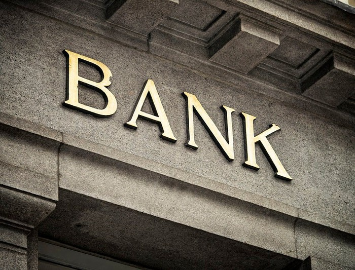 Bank sign on stone building.