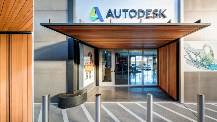 Entrance to building with Autodesk corporate logo above a wooden awning.