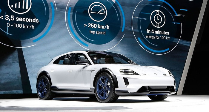 The Porsche Mission E Cross Turismo, a low-slung white SUV, on Porsche's show stand at the Geneva International Motor Show in March 2018.