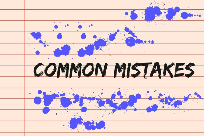 The phrase Common Mistakes with purple ink blots around it on light orange paper with red lines