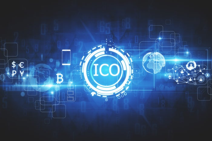 A digital rendering of the word ICO, surrounded by currency and bitcoin symbols.