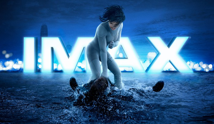 An IMAX ad for Ghost in the Shell with a woman standing over a person lying face up in water.