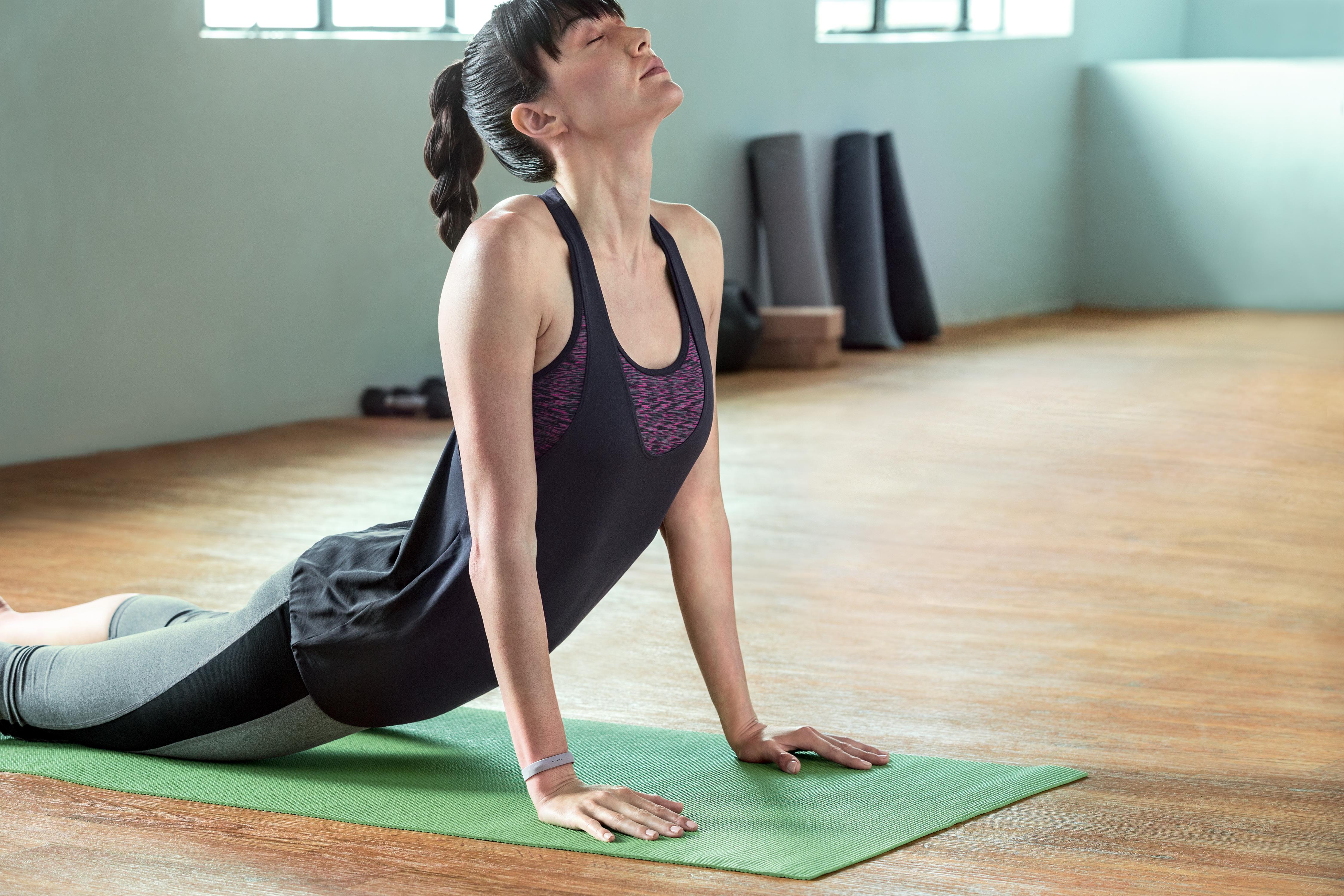 A woman wearing a Fitbit Flex 2.