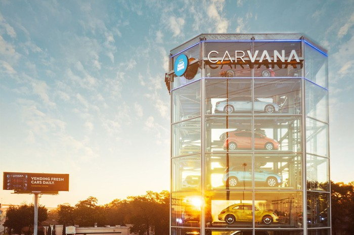 A close-up of the Carvana vending tower, glass-sided and full of cars.