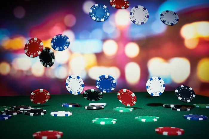 Casino chips falling on a gaming table.