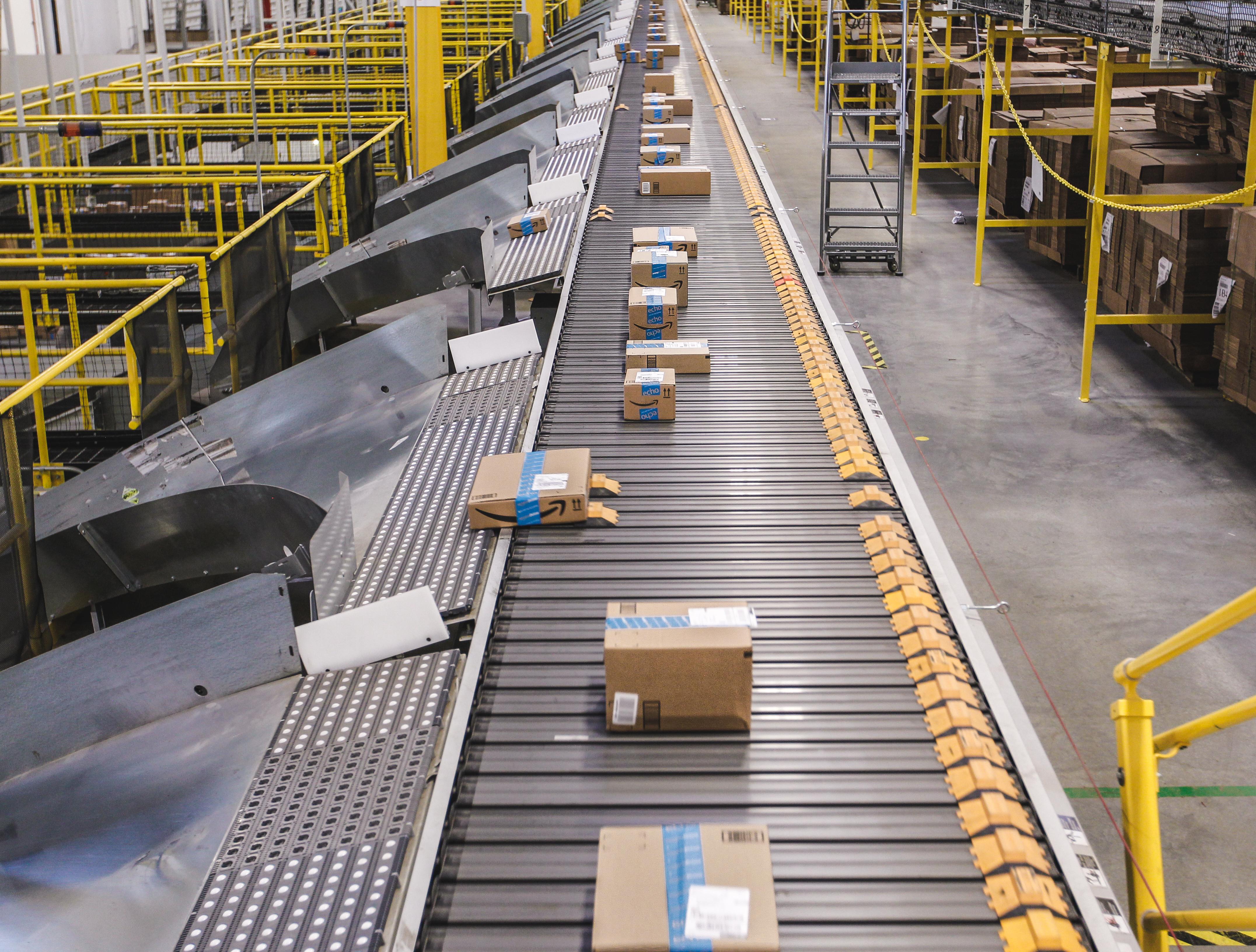 Amazon boxes on conveyor belt in Amazon fulfillment center