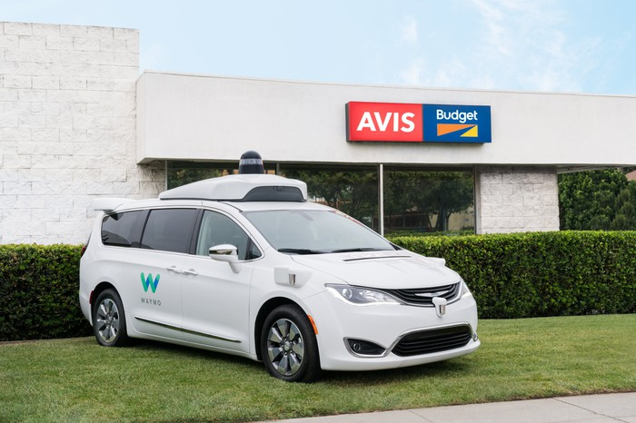 One of Waymo's self-driving Chrysler Pacifica's parked outside of an Avis Budget location.