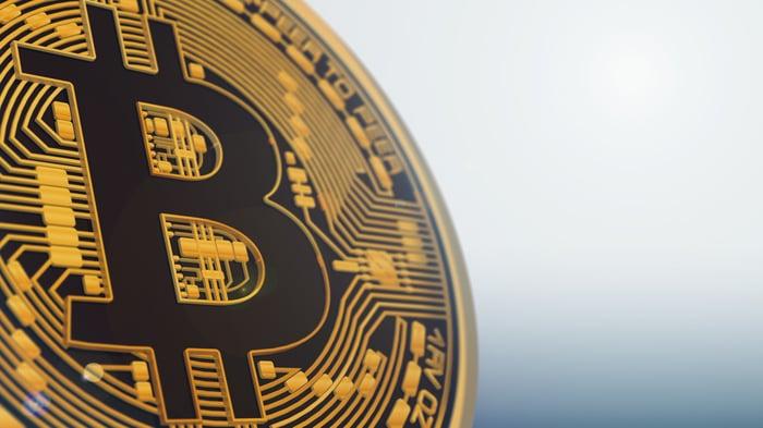 A physical gold bitcoin, up close.