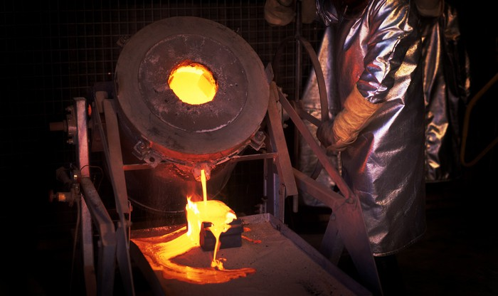 Molten metal being poured out of a foundry.
