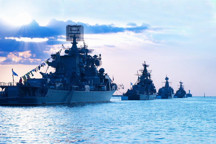 Warships sailing in a line