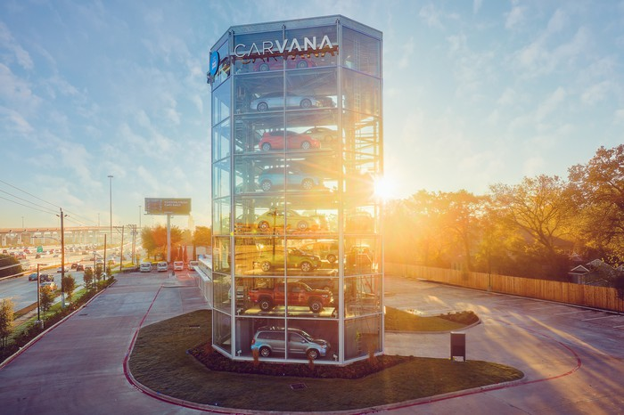 Vehicles parked inside a Carvana's multi-story vending machine concept.