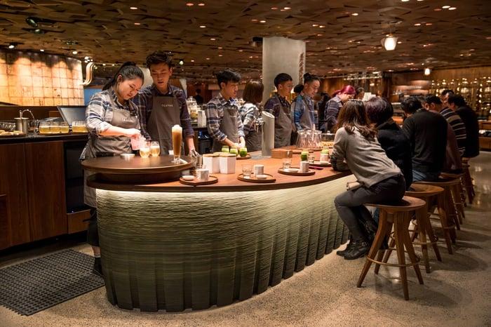 People gather around a bar in Starbucks' Shanghai Roastery.
