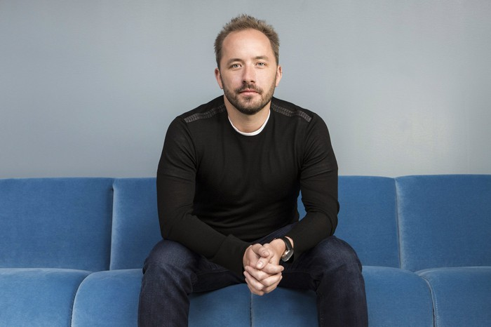 Drew Houston sitting on a couch