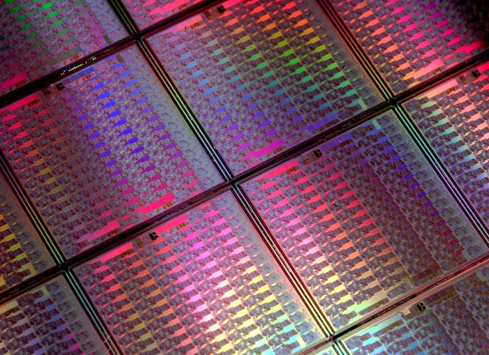 Close-up shot of a few uncut semiconductor wafers.