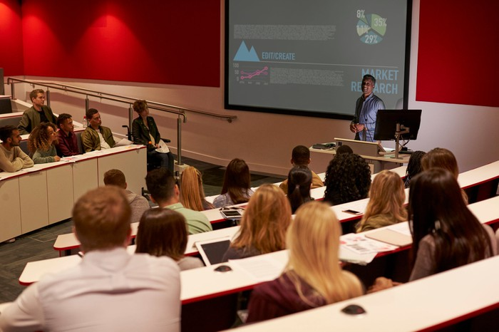 College students in rows at a lecture hall