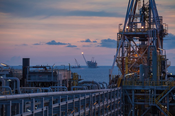 A floating production, storage, and offloading platform at dusk