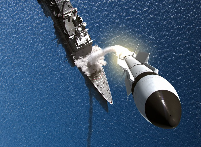 An ariel view of a warship firing a Raytheon missile interceptor.