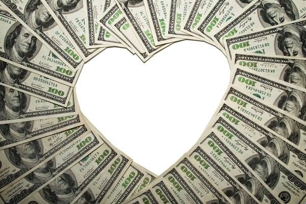 $100 bills forming heart