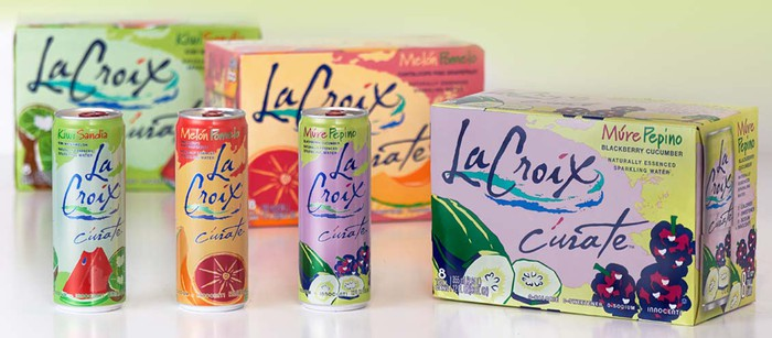 cans of La Croix Curate stands next to a case.
