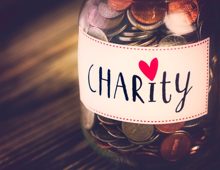Jar of coins labeled charity.