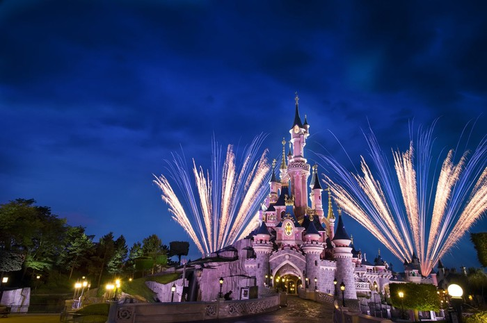 The Disneyland Castle at night with fireworks.