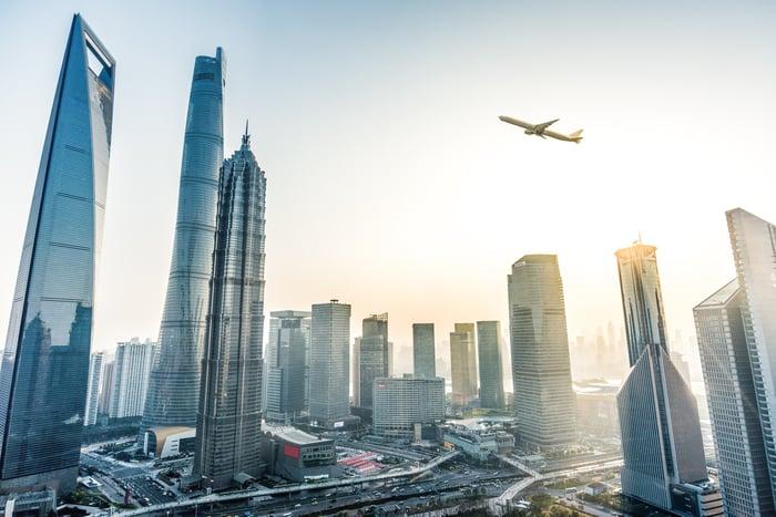 A plane flying over Shanghai