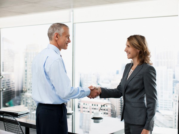 professionals shaking hands_GettyImages-107430233