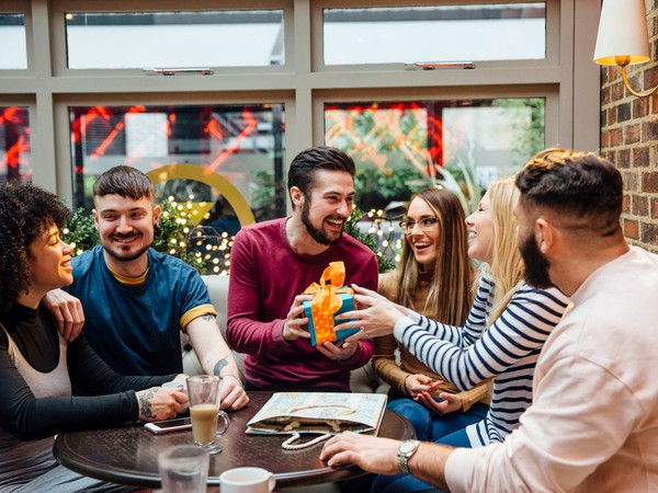 young adults sitting around a table_GettyImages-649668876