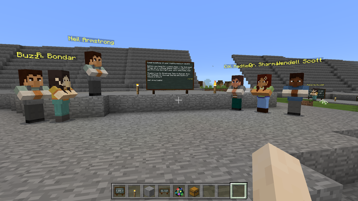 A first-person viewpoint of a Minecraft player looking at six other players.