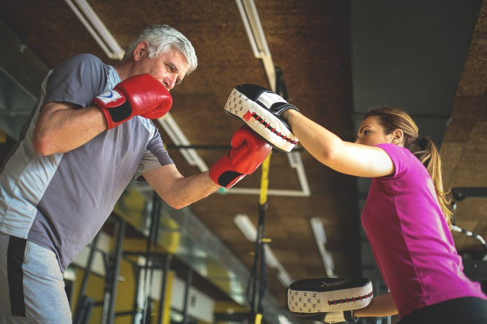Two boxers sparring in a gym