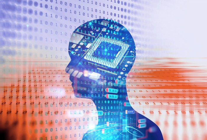 Outline of a human head containing a semiconductor chip with a background of the digits 0 and 1 -- concept for artificial intelligence.