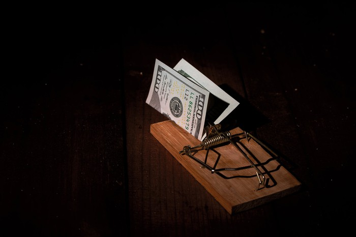 A mouse trap with $100 bill as bait.