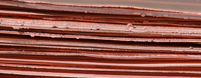 Long thin sheets of copper plate.