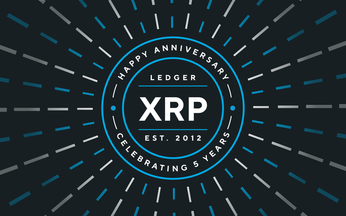 Blue circles and rays on black background celebrating XRP 5th anniversary.