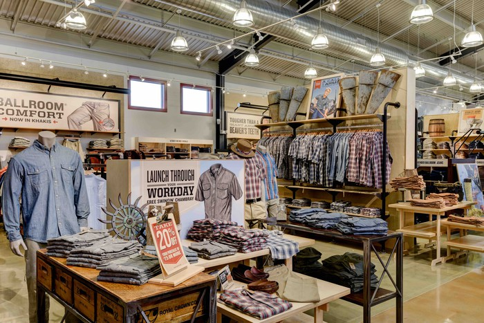 Inside view of a Duluth Trading men's department, with button-down shirts on display.