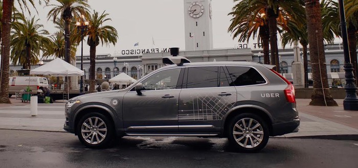 A Volvo SUV with Uber logos and visible self-driving sensor hardware is shown parked in San Francisco.