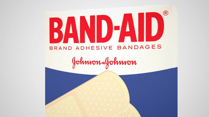 Front of Band-Aid box with red wording on white background and bandages over a blue background.