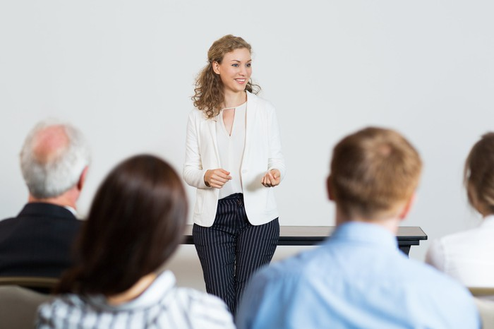 Professional woman speaking in front of an audience