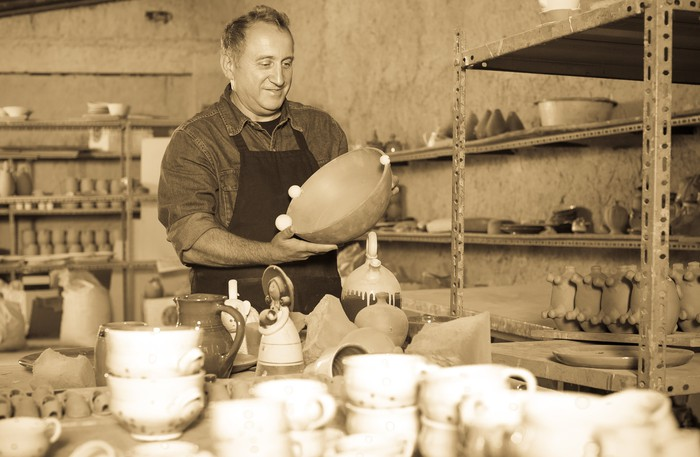 Man in a pottery shop.