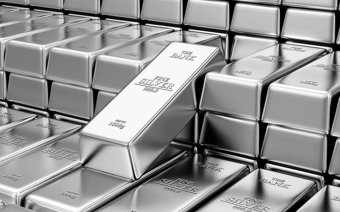 A silver bar standing out amid a stack of bars.
