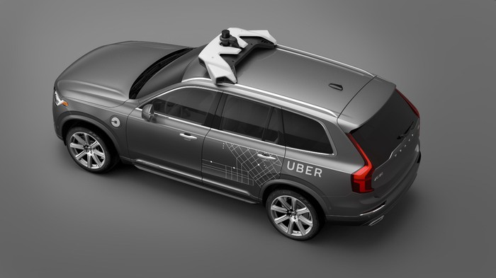 A Volvo SUV with Uber logos and visible self-driving sensor hardware, shown from above.