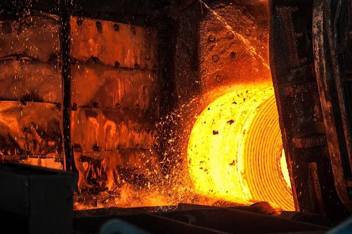 A hot roll of steel in a steel mill.