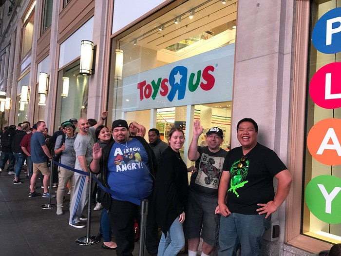People waiting in line for Toys R Us to open