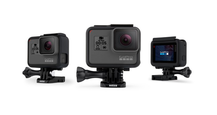 GoPro action cameras in mounting frames.