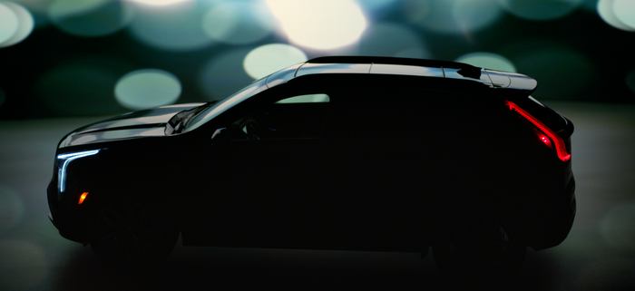 "A Cadillac XT4's outline is visible in a darkened ""teaser"" image."