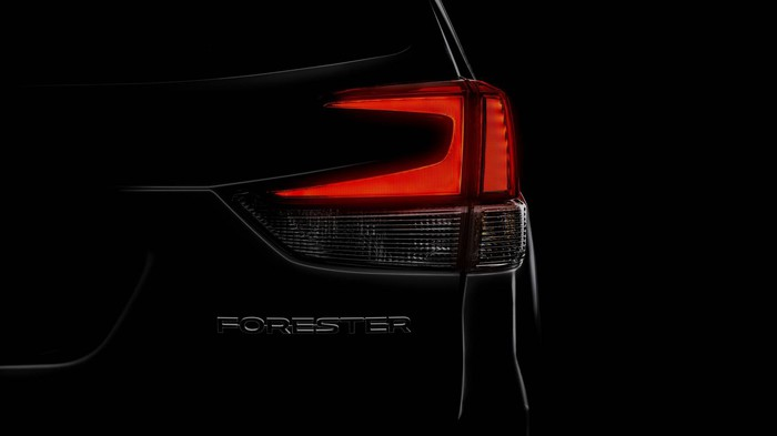 "A darkened ""teaser"" image showing the taillight of the new Forester."