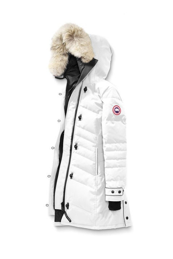 White parka with fur hood featuring Canada Goose oval logo on shoulder.