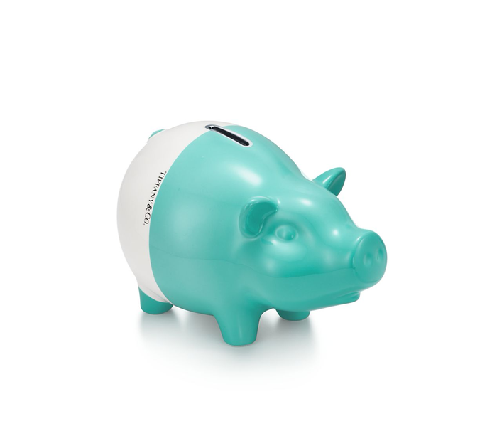A white and green piggy bank.