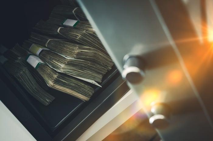 Stacks of cash sitting inside a safe.