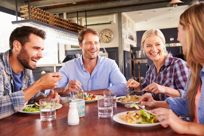A group of people eat at a restaurant.